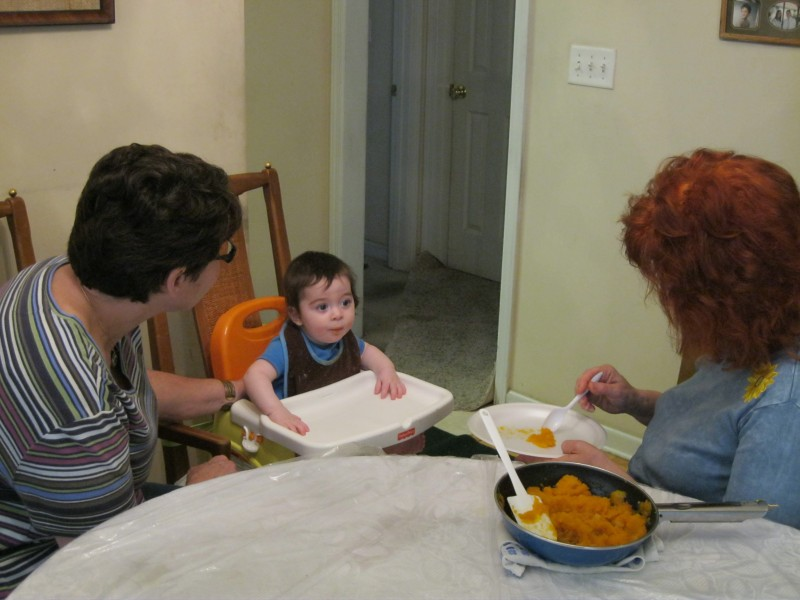 Grandma and Bubby feeding the baby (a/k/a grand mommies in totally bliss), last Pesach